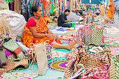 Kolkata, West Bengal, India - November 28, 2015: Woman hand weaving jute bags, handicrafts on display during the Handicraft Fair in Kolkata. Biggest handicrafts fair in Asia.