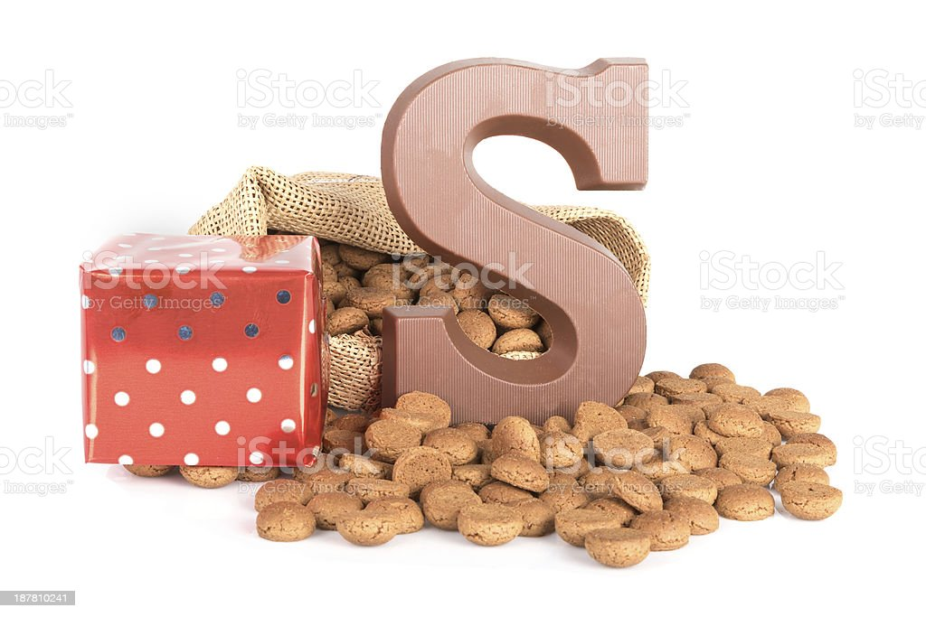 Jute bag with chocolate, ginger nuts and presents stock photo