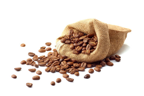 Jute bag with coffee beans on white Jute bag with roasted coffee beans isolated on white background roasted coffee bean stock pictures, royalty-free photos & images