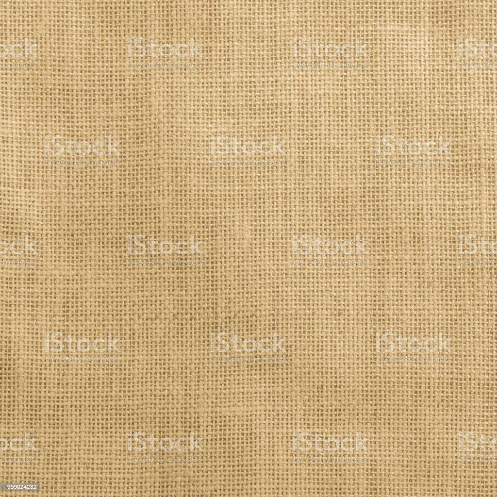 Jute fabric sackcloth burlap texture background yellow cream brown color stock photo