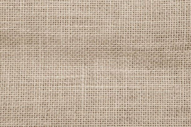 jute hessian sackcloth woven burlap texture background in sepia cream old aged brown color - sisal stock pictures, royalty-free photos & images