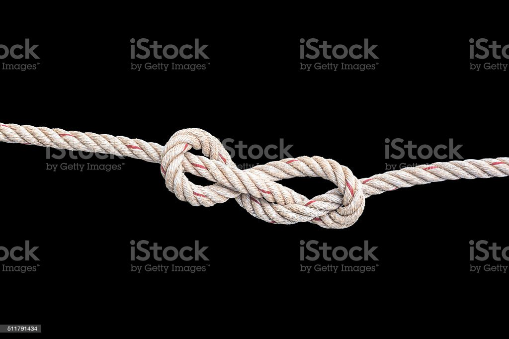 Jute Rope With Knot Isolated On Black Background Stock Photo