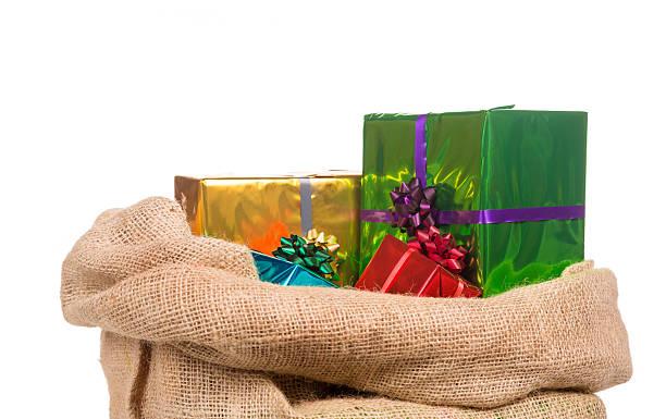 jute sack of saint nicholas with presents - cadeau sinterklaas stockfoto's en -beelden