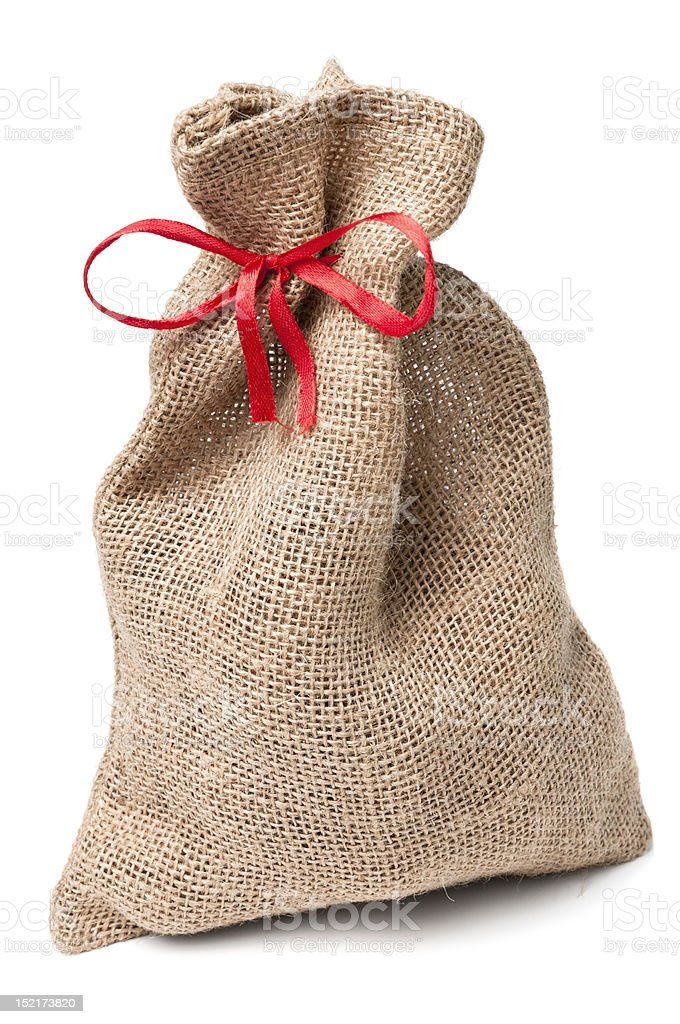 Jute sack present with red ribbon royalty-free stock photo