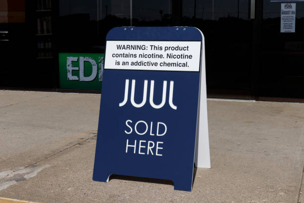 Juul e-cigarette sign. While e-cigarettes help people quit smoking, officials are alarmed at the skyrocketing use by teenagers, children and adolescents stock photo
