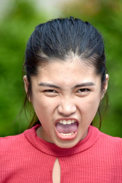 A Juvenile And Anger A person in an outdoor setting antagonize stock pictures, royalty-free photos & images