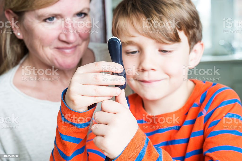 Juvenile diabetes patient with his mother stock photo