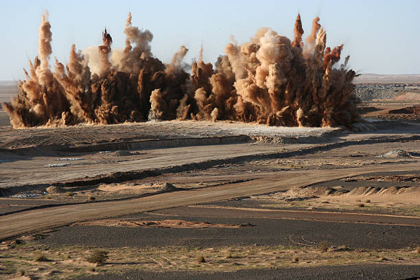 Ka Boom Surface blast on a gold mine in the Sahara Desert. explosive stock pictures, royalty-free photos & images