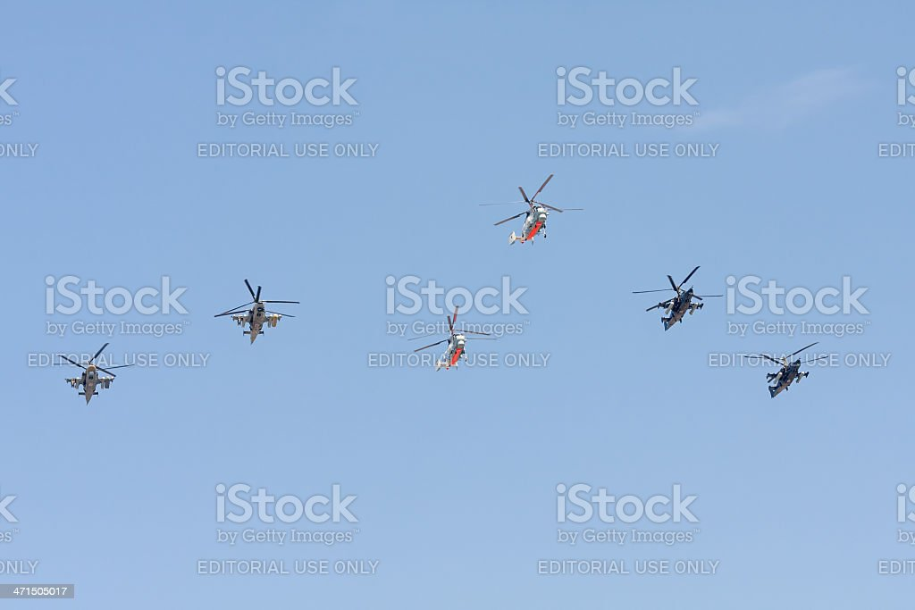 Ka-27, Ka-50 Black Shark,  Ka-52 Alligator helicopters against sky background. royalty-free stock photo