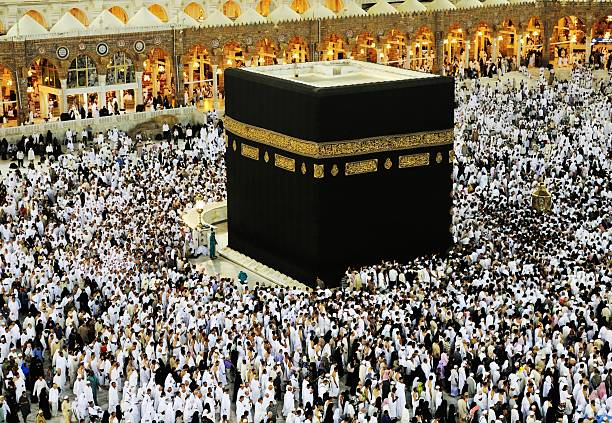 Kaaba in Mecca, Muslim people praying together at holy place Kaaba in Mecca, Muslim people praying together at holy place circumambulation stock pictures, royalty-free photos & images