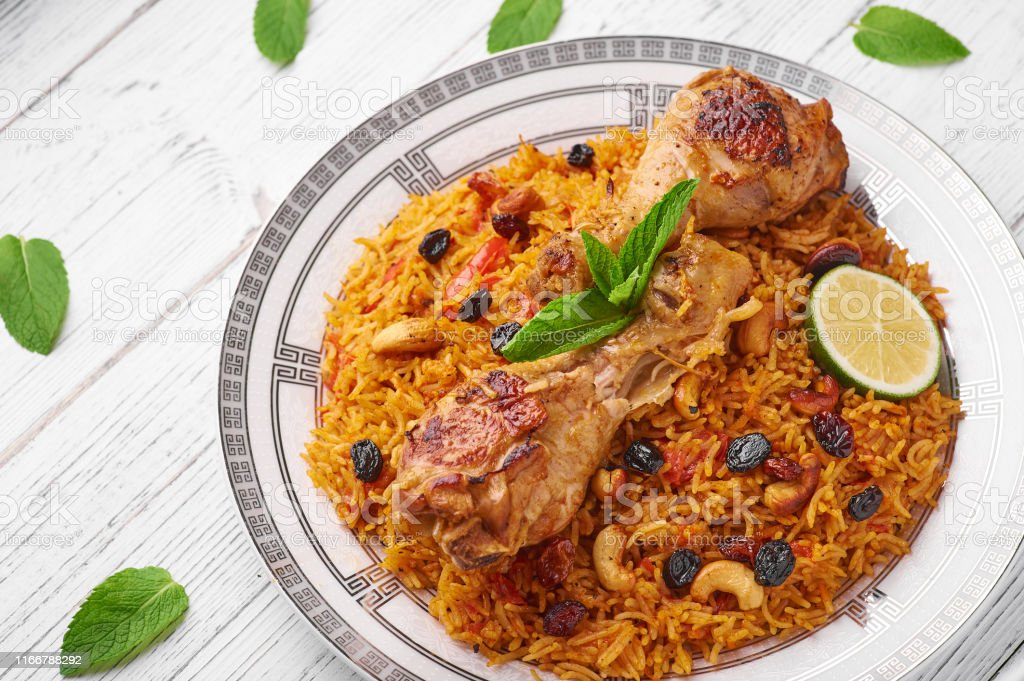 Kabsa At White Wooden Background Kabsa Is Traditional Saudi Arabian Cuisine Dish Stock Photo Download Image Now Istock