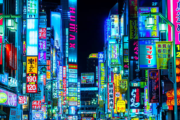 Kabuki-Cho district, Shinjuku,Tokyo, Japan. Tokyo, Japan - November 13, 2014: Billboards and neon signs line Shinjuku's Kabuki-cho district. The area is a nightlife district known as Sleepless Town. tokyo stock pictures, royalty-free photos & images