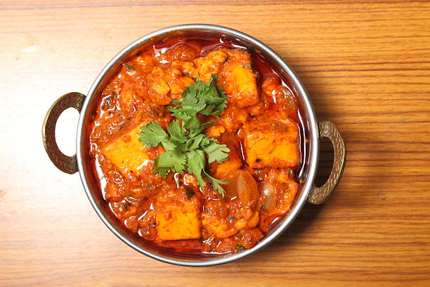 INDIAN STYLE COTTAGE CHEESE VEGETARIAN CURRY DISH. Kadai Paneer. INDIAN STYLE COTTAGE CHEESE VEGETARIAN CURRY DISH. Kadai Paneer - traditional Indian food. balti dish stock pictures, royalty-free photos & images