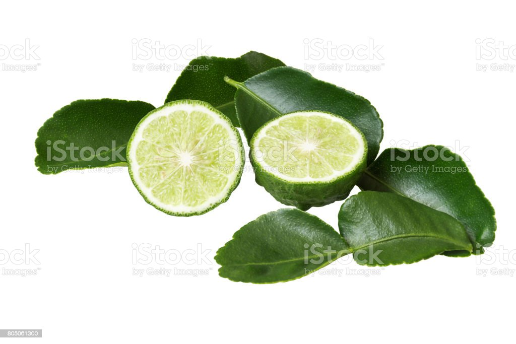 Kaffir lime leaves and lime that doing half.  Both the leaves and fruit can be used to cook. And the herb has many benefits, such as used as ingredients to prevent dandruff shampoo on your head. stock photo
