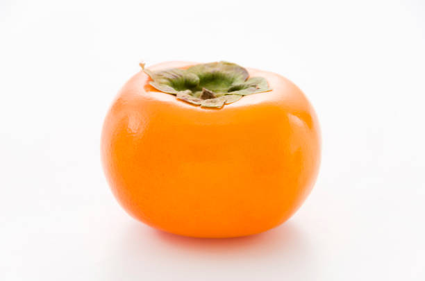 kaki, persimmon - sharonfrucht stock-fotos und bilder