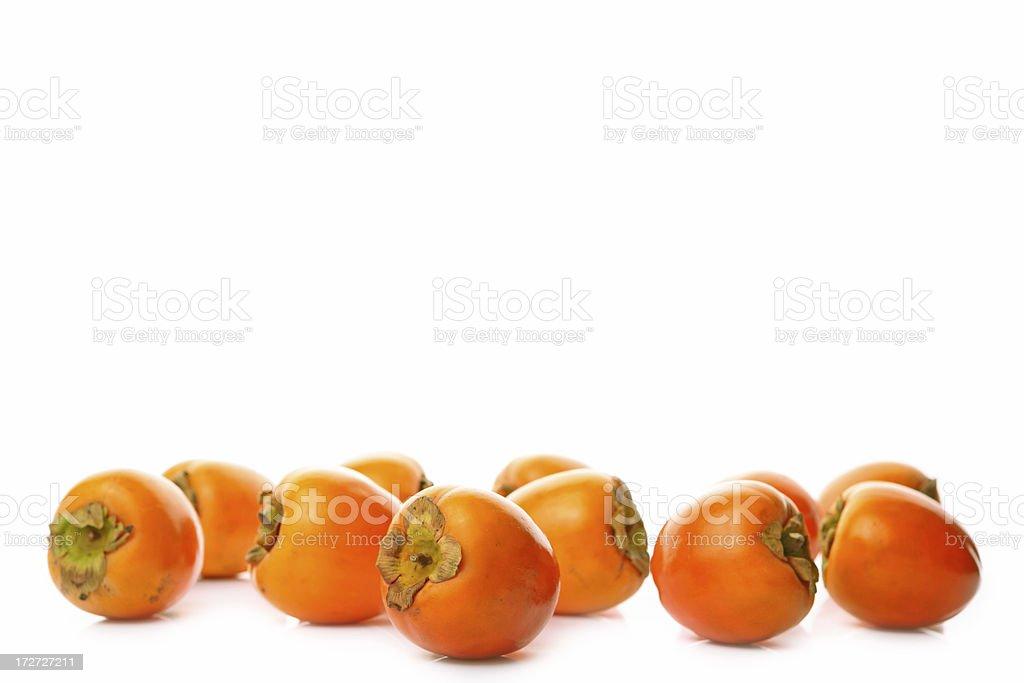 kakis - japanese persimmon stock photo