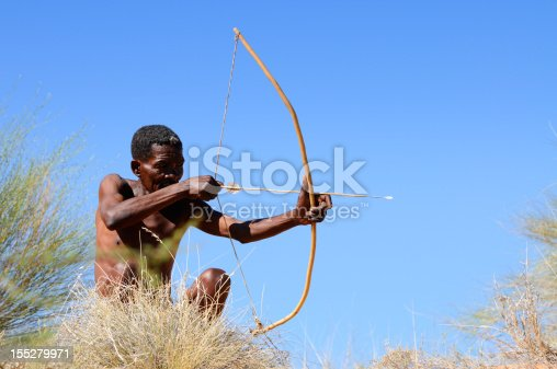 A Kalahari bushman of the !Khomani tribe aims his bow and arrow. My San people collection is a pet project close to my heart. I'd be most grateful if you could sitemail me to let me know where you use these images.