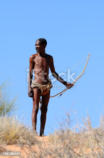 A lone Kalahari bushman from the !Khomani tribe on a dune. My San people collection is a pet project close to my heart. I'd be most grateful if you could sitemail me to let me know where you use these images.