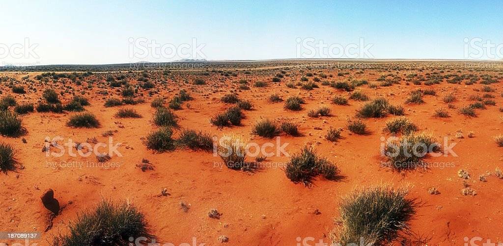 Kalahari Desert with dry, red-earth savannah stretching into the distance stock photo
