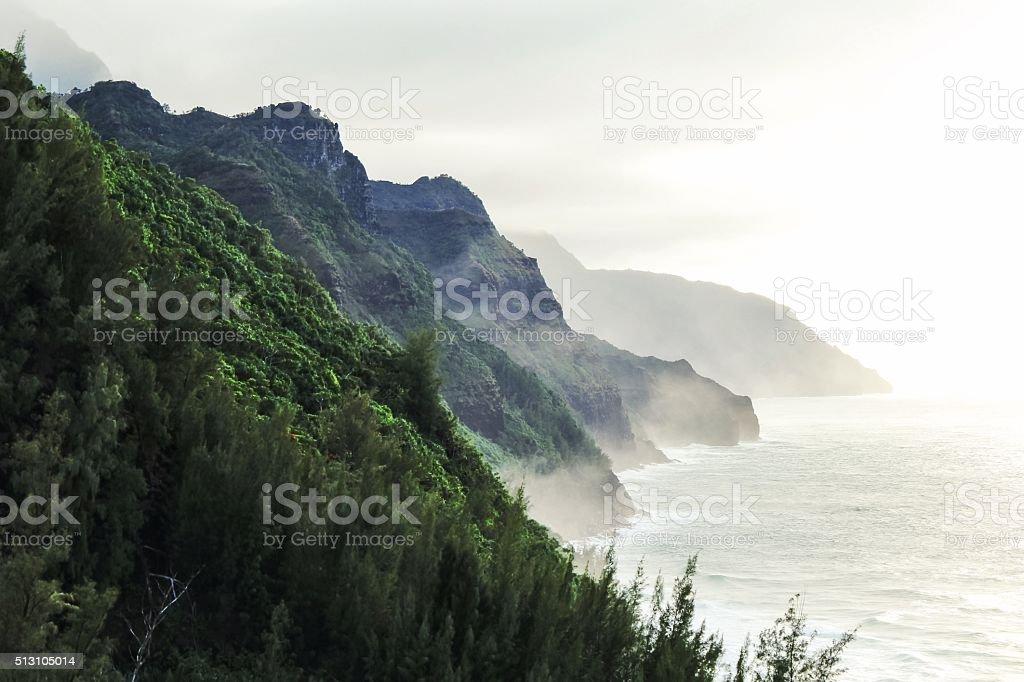 Kalalau trail at Kauai, Hawaii in foggy day stock photo