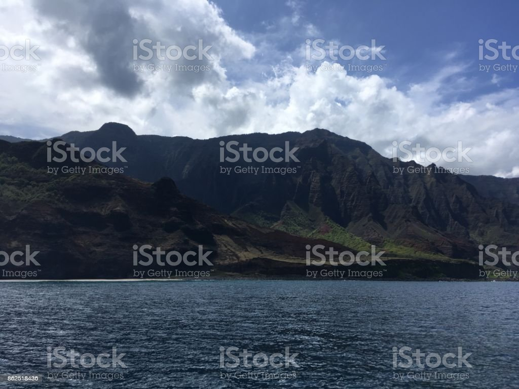 Kalalau Valley Mountains and Cliffs on Napali Coast on Kauai Island in Hawaii - View from Pacific Ocean. stock photo