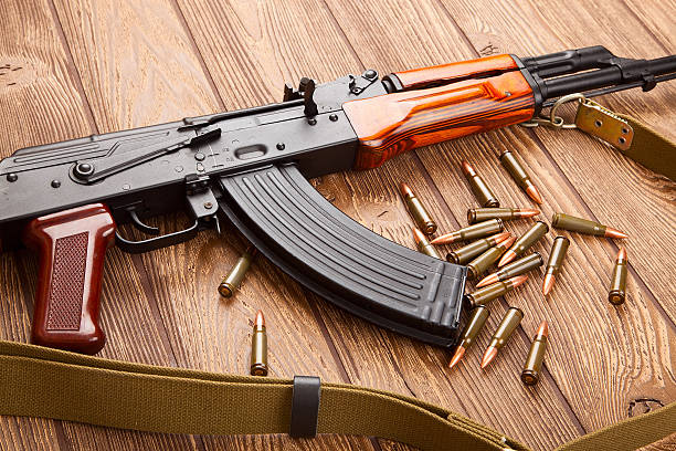 Kalashnikov assault rifles with ammunition stock photo