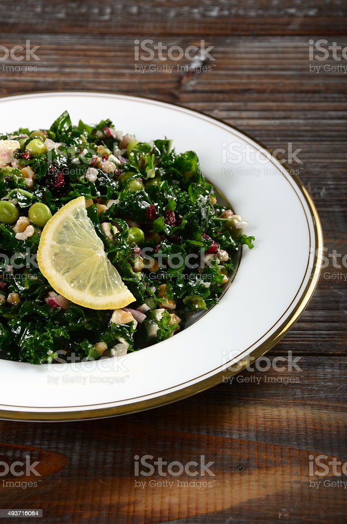 Kale and Farro Salad with Feta and Cranberries stock photo