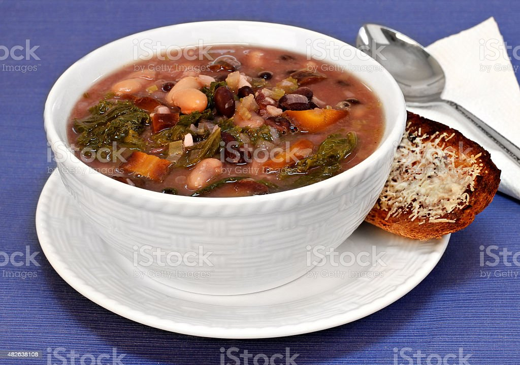 Kale, bean and vegetable soup close up. stock photo