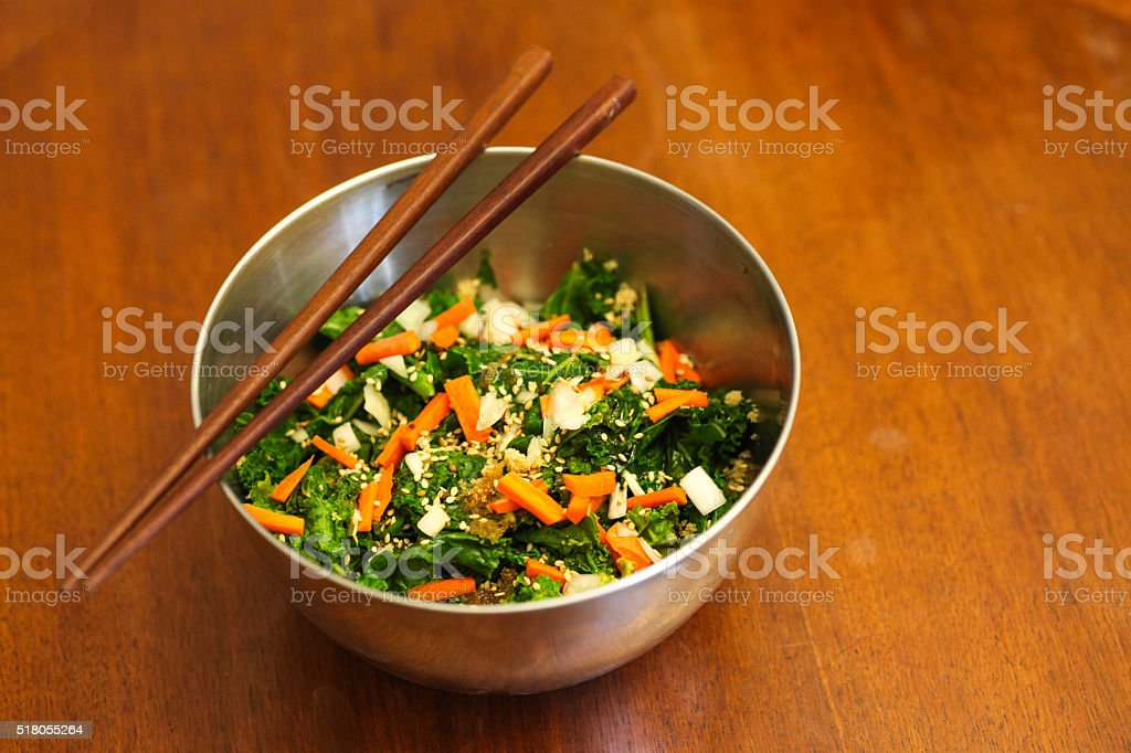 Kale carrot salad with chopsticks stock photo