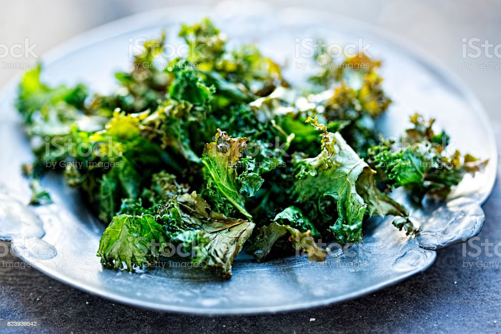 Kale chips with chilli flakes stock photo