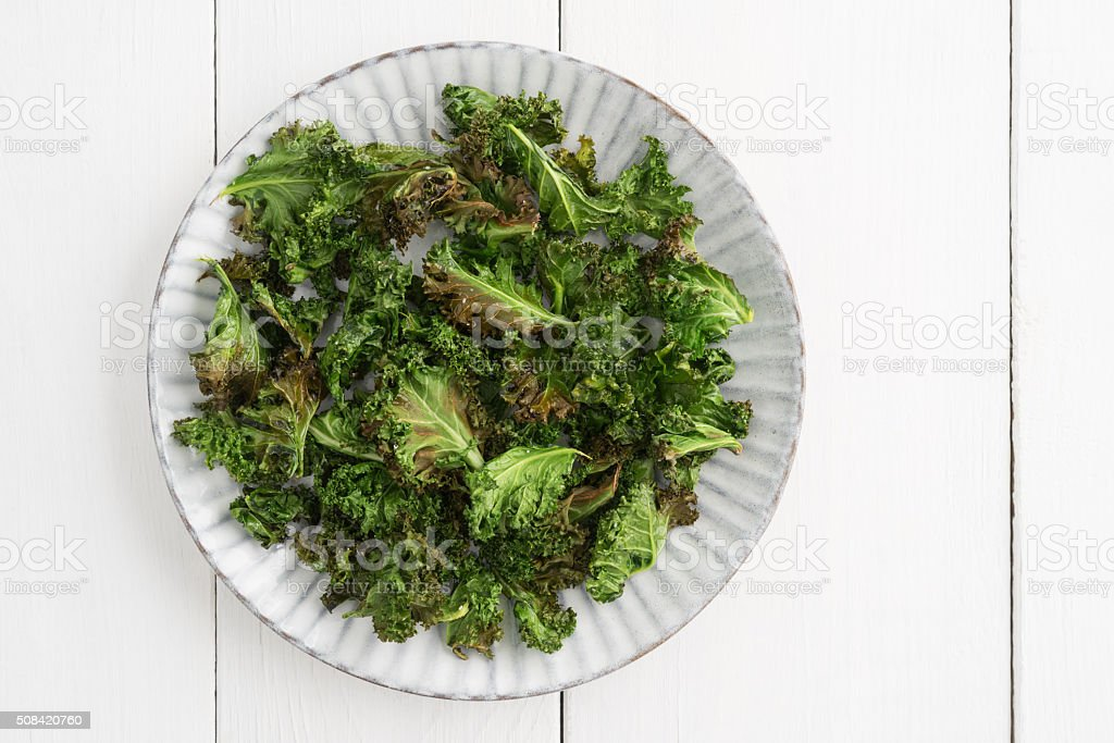 Kale chips with sea salt stock photo