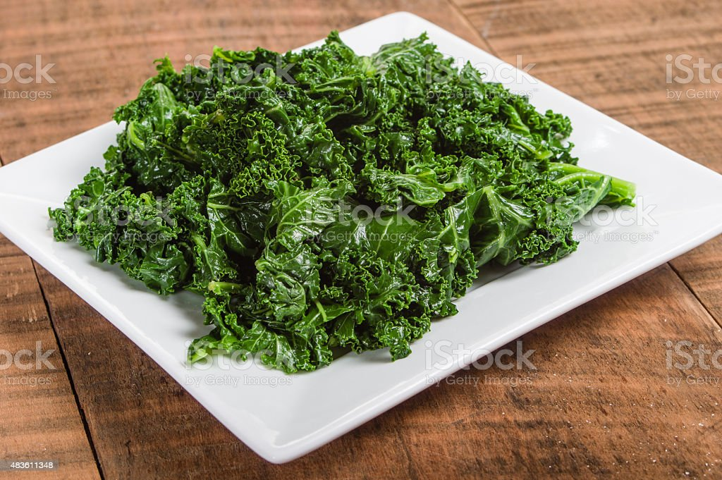 Kale greens on white plate stock photo