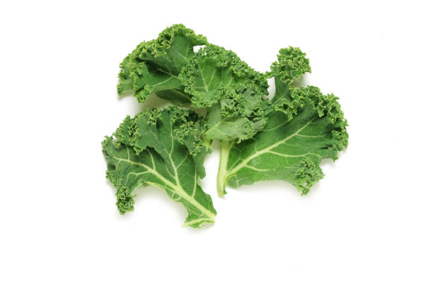 Kale leaves shot from above isolated on white background Kale leaves shot from above isolated on white background kale stock pictures, royalty-free photos & images