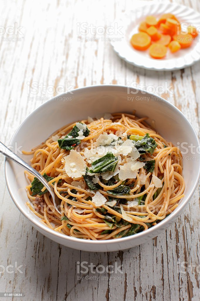 Kale Pasta Dish with carrots drizzled with honey stock photo