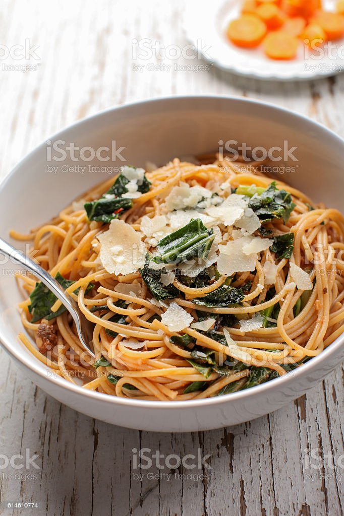 Kale Pasta Dish with carrots stock photo