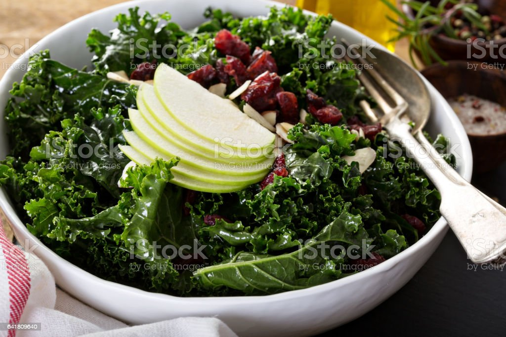 Kale salad with dried cranberry and apple stock photo