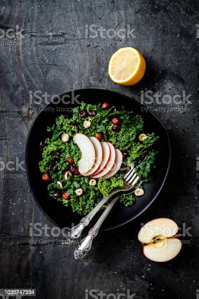 Photo of Kale salad with dried cranberry, hazelnuts and sliced apple