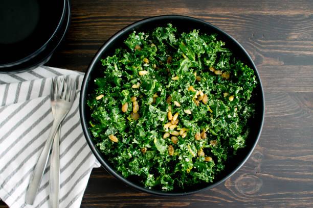 Kale Salad with Lemon Dressing A bowl of kale salad kale stock pictures, royalty-free photos & images