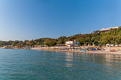 Kallithea, Greece - September 03,2019: Kalithea Beach (Greek: Παραλία Καλλιθέα) the most beautiful beach in Kallithea, Halkidiki in Greece.