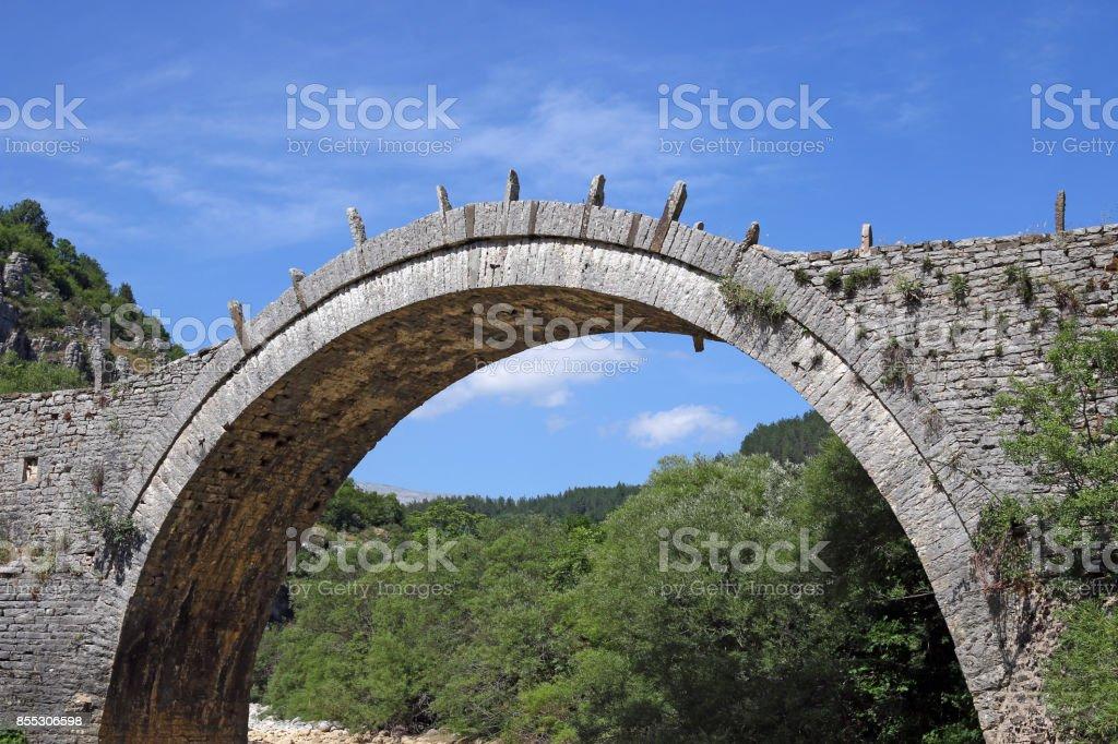 Kalogeriko arched stone bridge Zagoria Greece stock photo