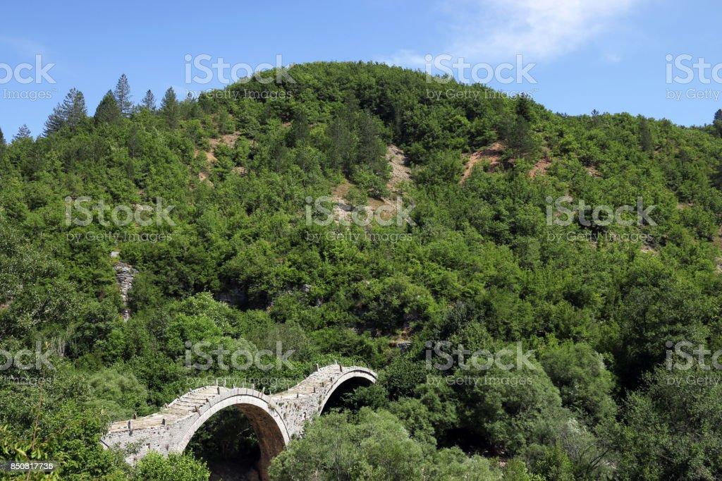 Kalogeriko stone bridge on Vikos gorge Zagoria landscape stock photo