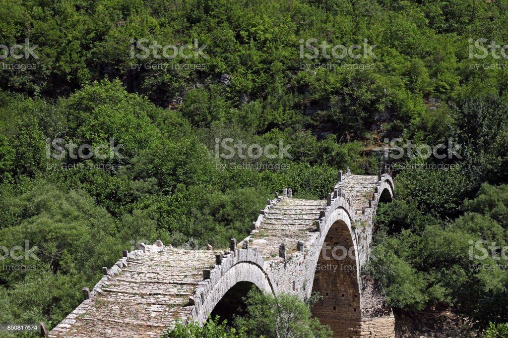 Kalogeriko stone bridge on Vikos gorge Zagoria stock photo