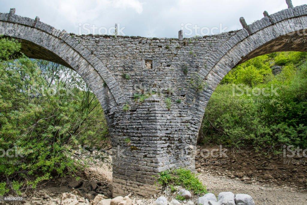 Kalogeriko triple arched stone bridge stock photo