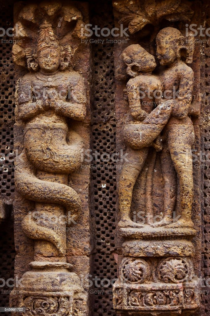 Kama Sutra and religion on temple wall stock photo