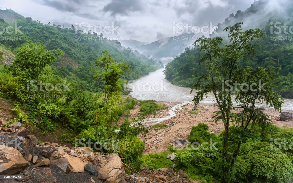 Kameng river and forested valley in monsoon in Himalayas, Arunachal Pradesh, India. stock photo