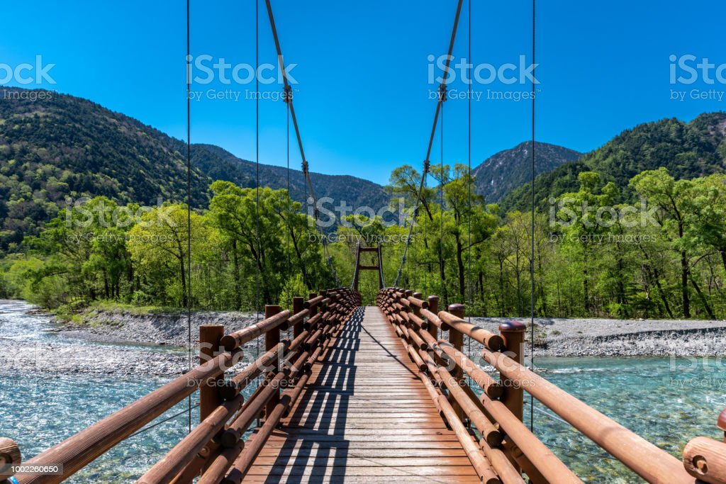 Kamikochi bridge over stream stock photo