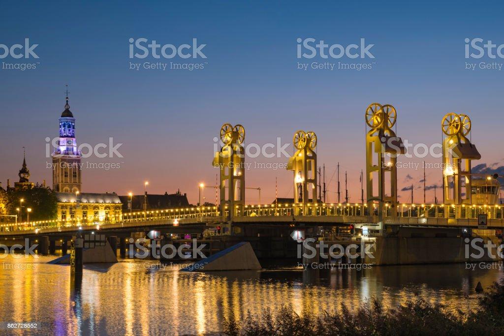Kampen city bridge over the river IJssel during the night stock photo