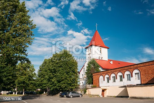 istock Kamyenyets, Brest Region, Belarus. Sts Peter And Paul Roman Catholic Church In Sunny Summer Day In Kamenets 1003767730