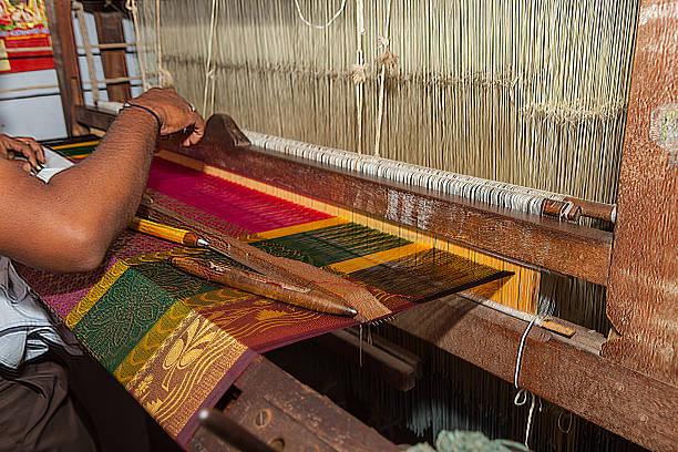 Kanchipuram, India - Weaving the famous Kanchipuram Silk Sari stock photo