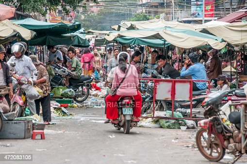 Phnom Penh, Cambodia - November 16, 2013: A busy scene of shoppers and market vendors in Kandal Street Market in the Cambodian Capital of Phnom Penh